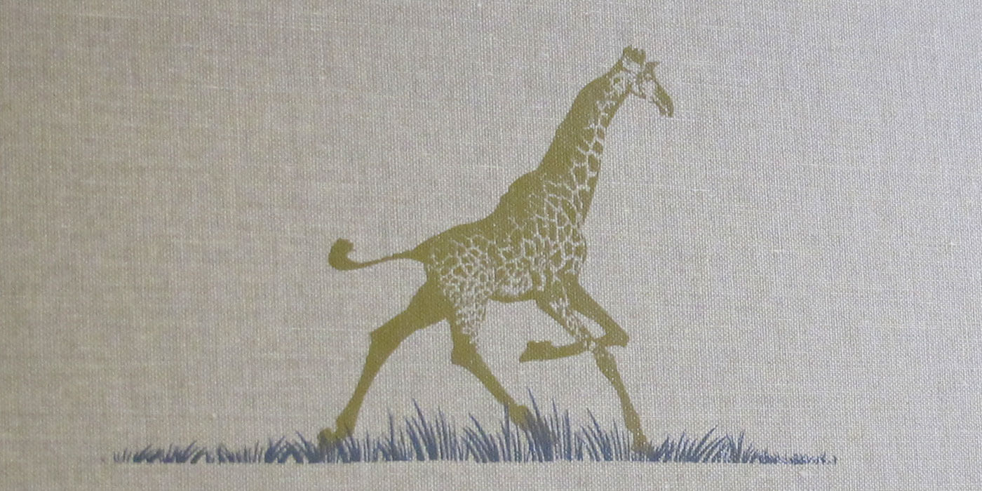 Lexington Furniture's Henry Link Trading Company natural canvas binder with giraffe illustration in gold ink