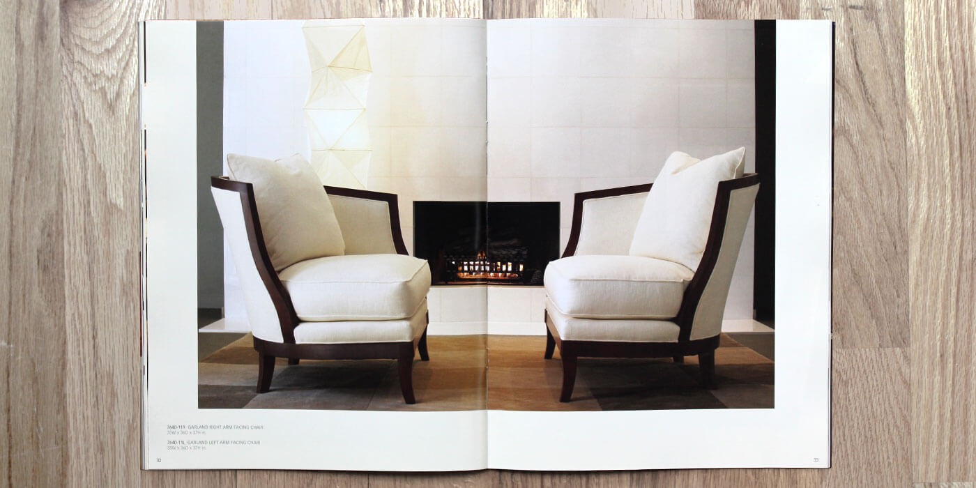 Lexington Furniture Zacara catalog spread showing two white upholstered arm chairs with dark wood finish. Chairs shown facing one another in front of a fireplace.