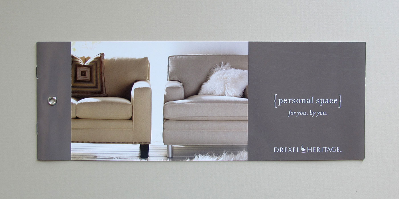 "Drexel Heritage brochure cover with rivet binding and headline ""Personal Space"" with custom sofa and chair"