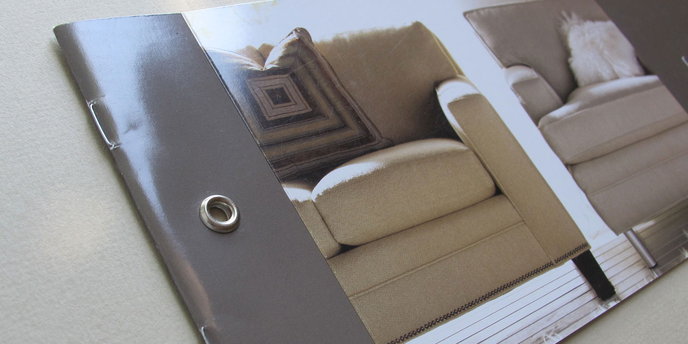 "Detail of a Drexel Heritage brochure cover with rivet binding and headline ""Personal Space"" showing custom sofa and chair"