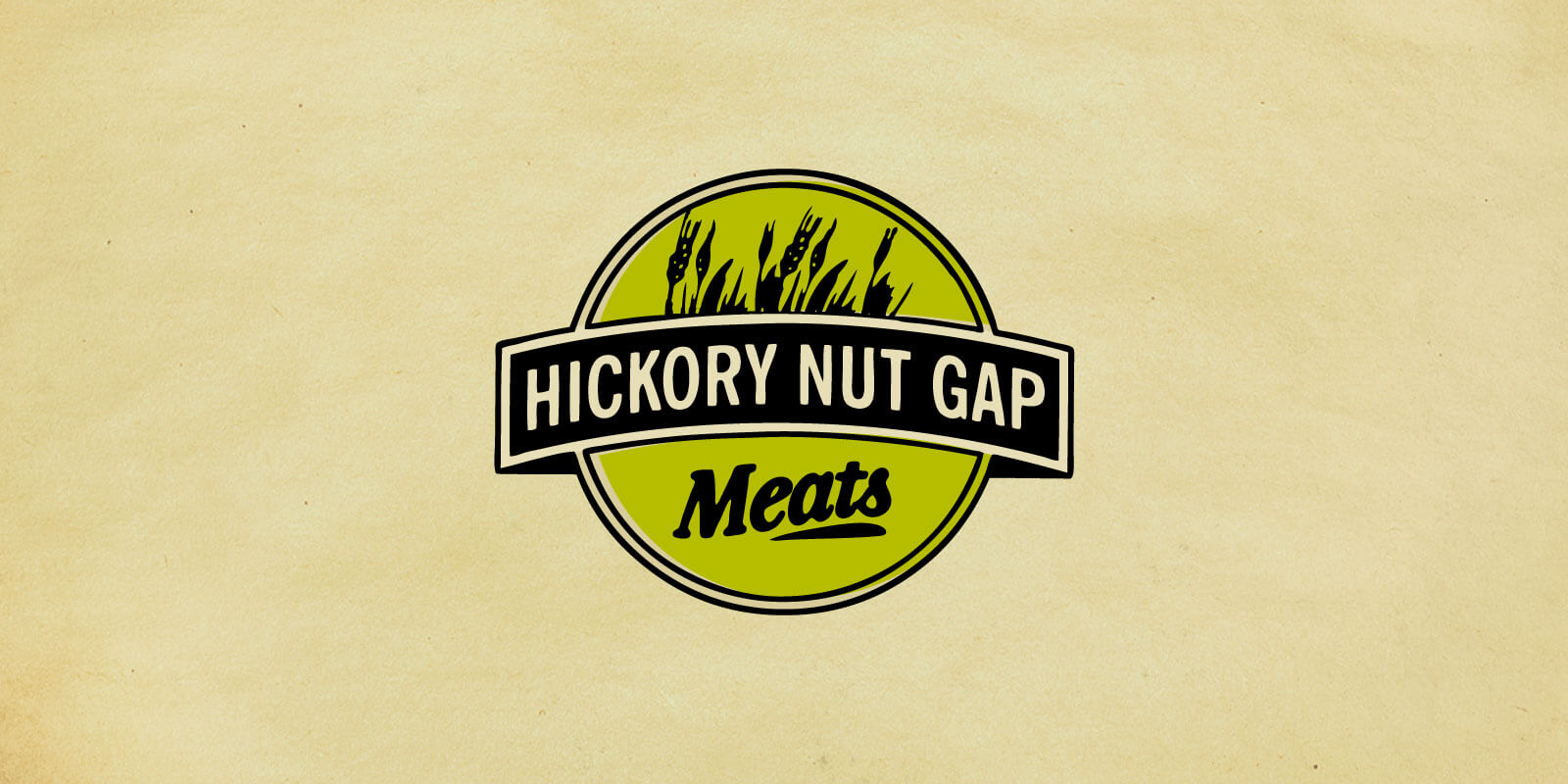 Hickory Nut Gap Meats logos in green and black shown against parchment paper background.