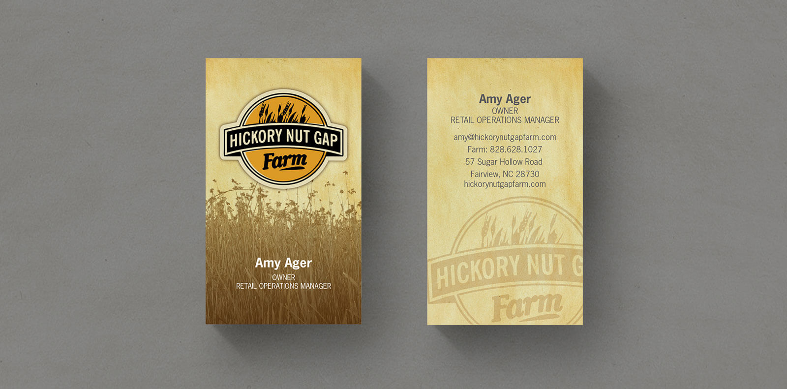 Hickory Nut Gap Farm business card with logo and grass centered