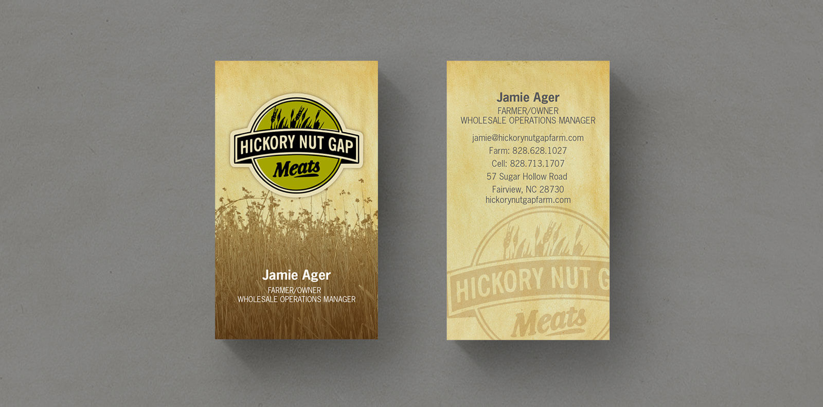 Hickory Nut Gap Meats business card with logo and grass centered