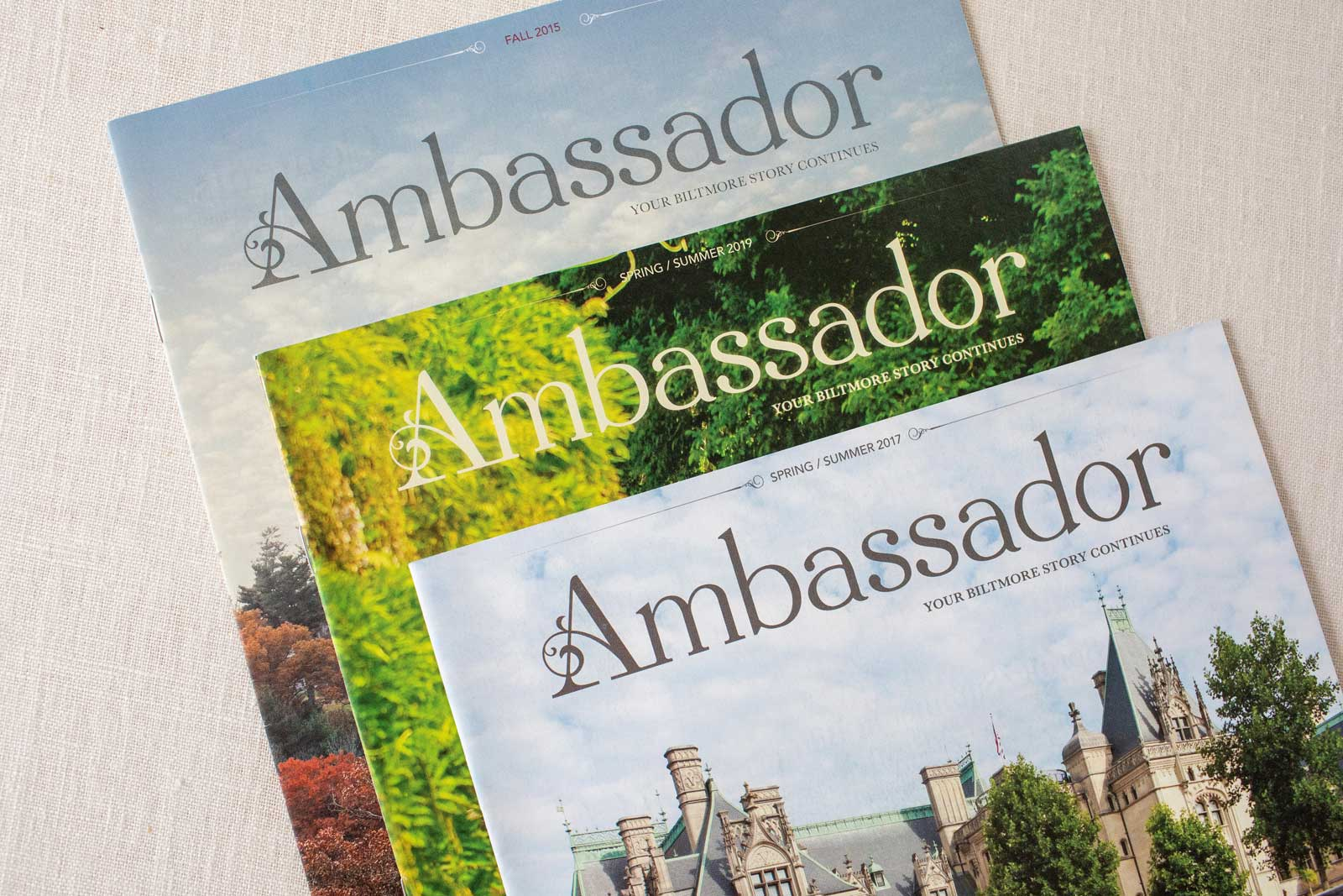 Biltmore Estate Ambassador Magazine covers with the front of Biltmore House in Spring