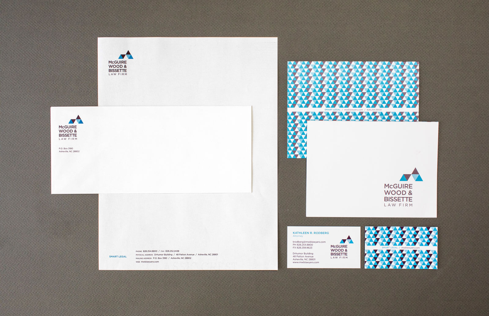 McGuire Wood & Bissette Law Firm stationery set of letterhead, business card, envelope, notecard, arranged on a gray background.
