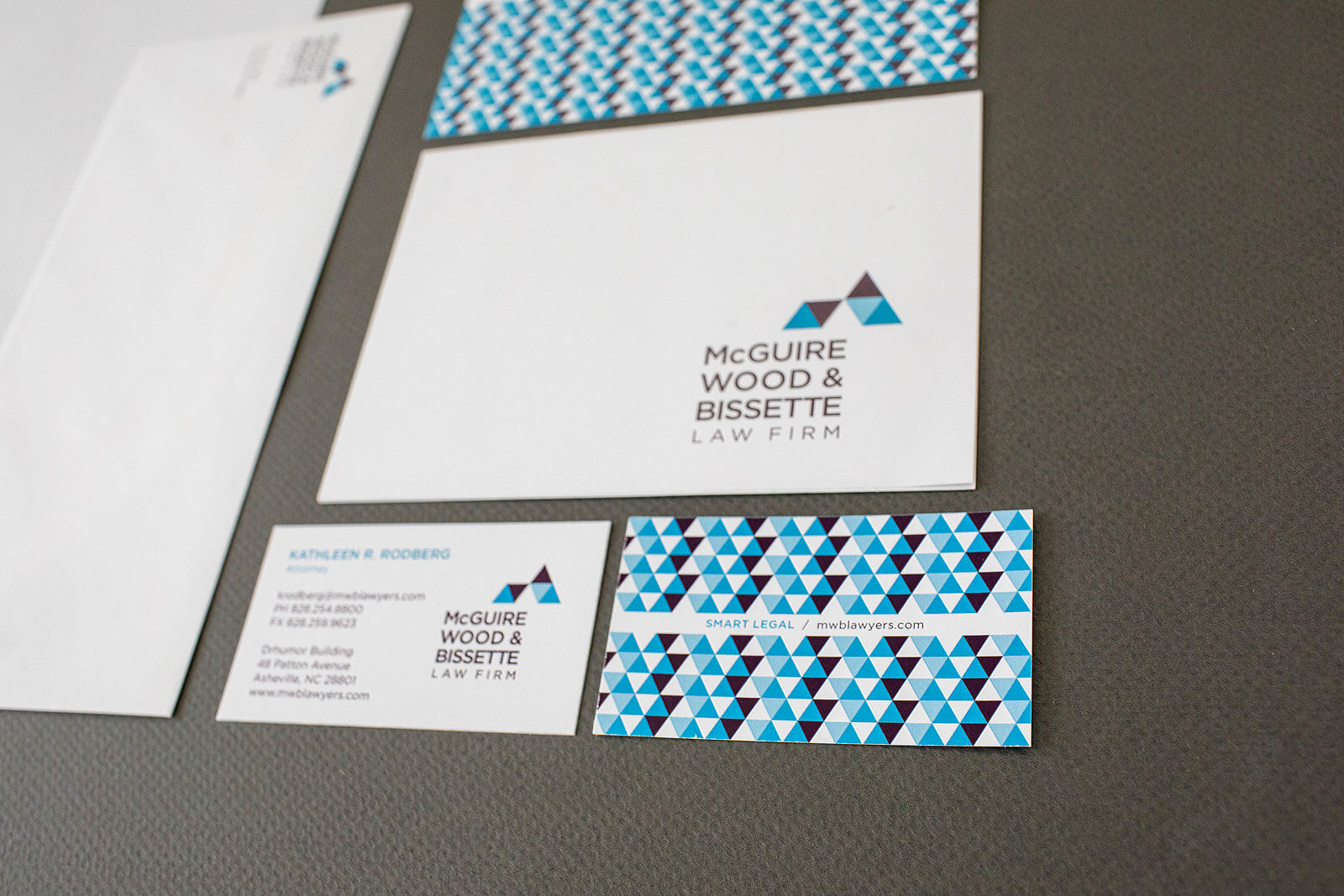 McGuire Wood & Bissette Law Firm stationery set detail showing a blue and burgundy triangle pattern.