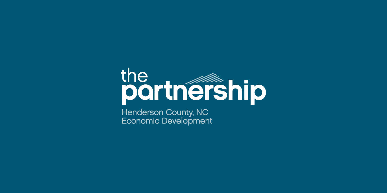 Henderson County Partnership for Economic Development (HCPED) logo in white, centered against a blue background