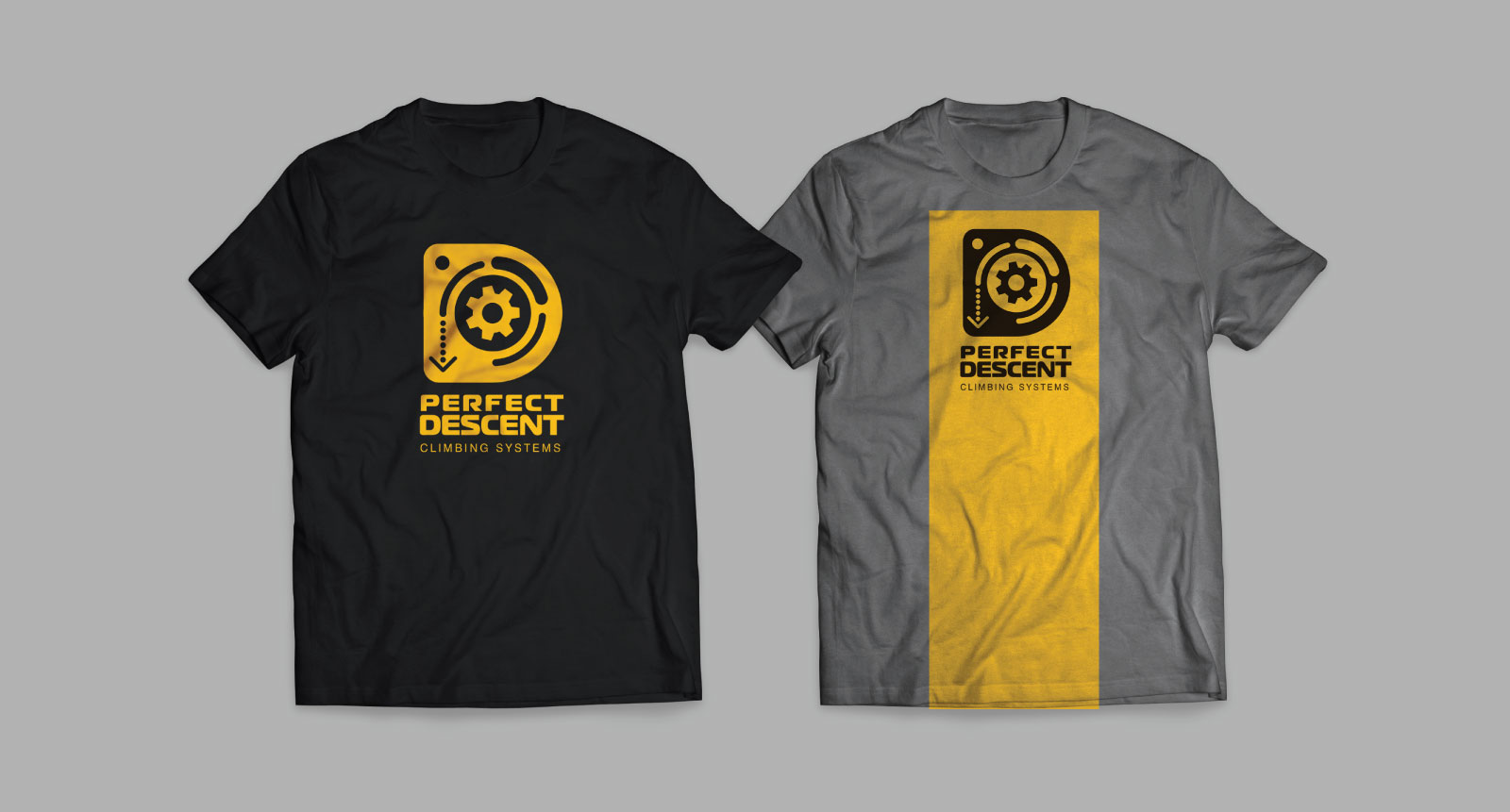 Perfect Descent t-shirts with yellow D gear logo on black shirt and black logo on a gray shirt