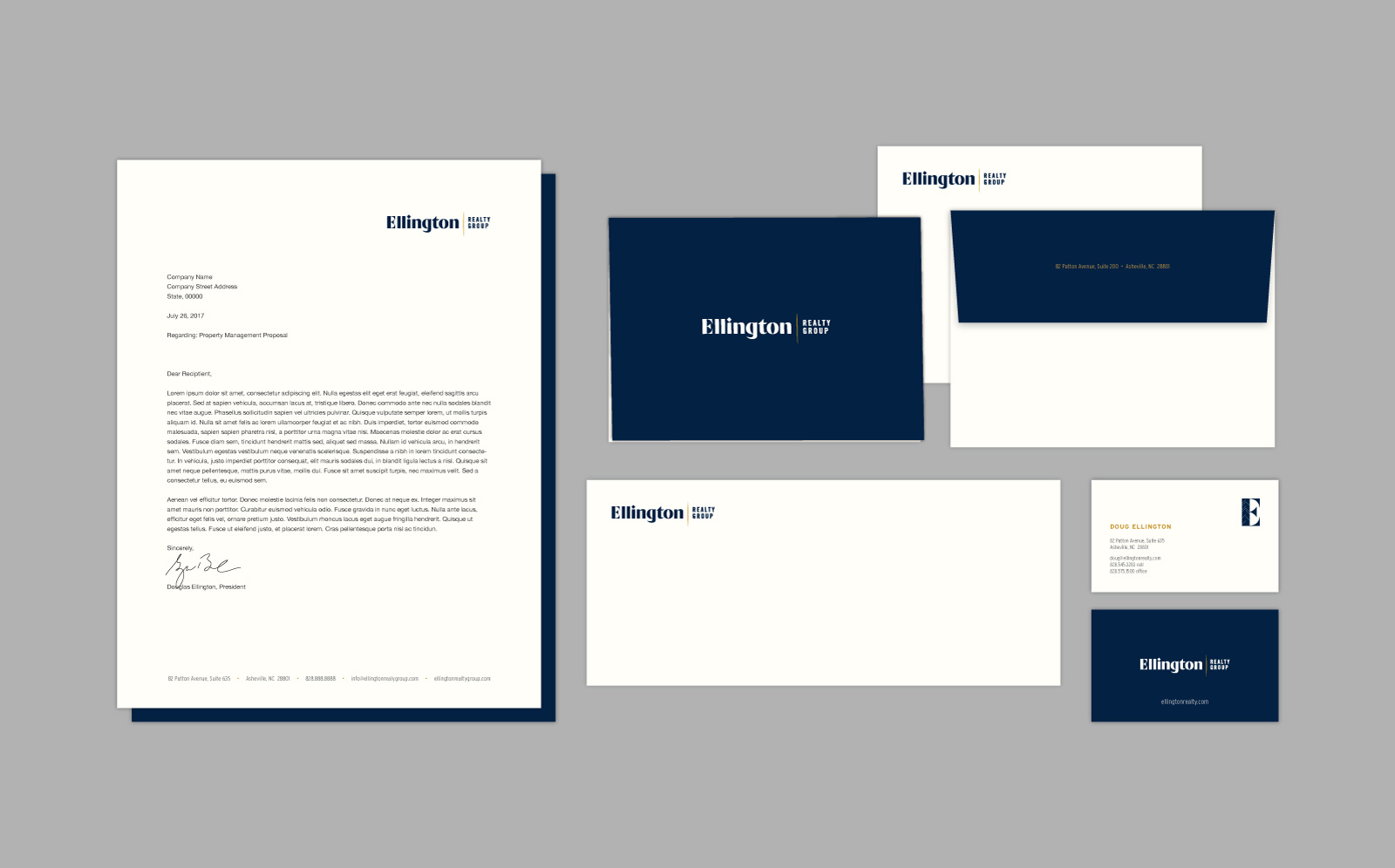 Ellington Realty Group stationery with letterhead, envelope, business card, and note card shown arranged on a gray background