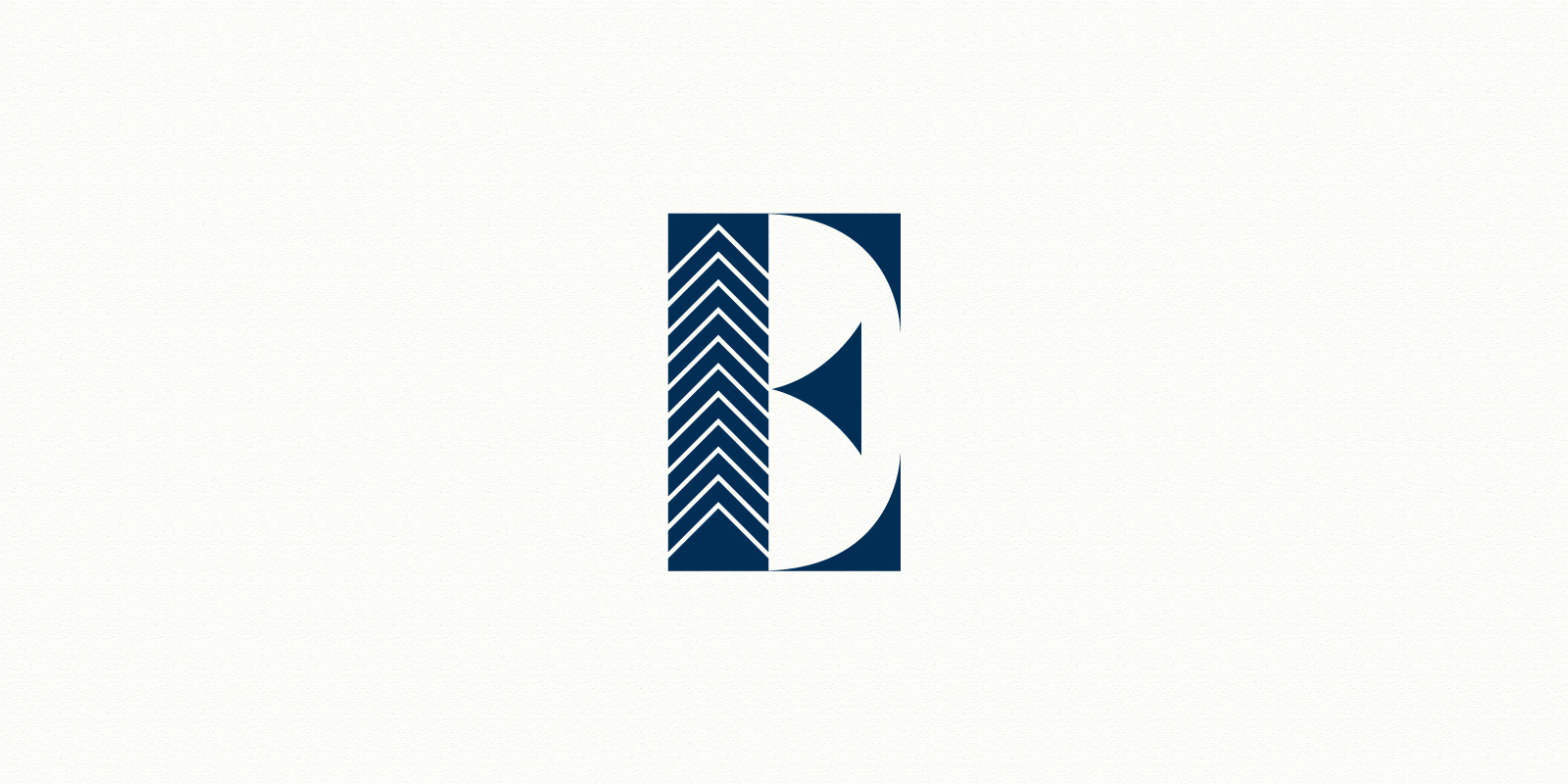 "Ellington Realty Group large ""E"" logo in blue against off-white background"