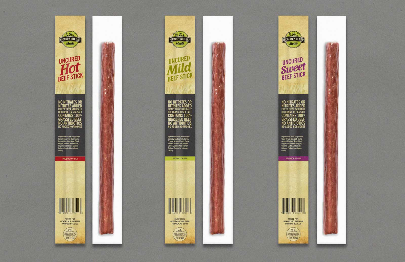 Hickory Nut Gap Meats Beef Sticks (Hot, Mild and Sweet) shown on gray background.