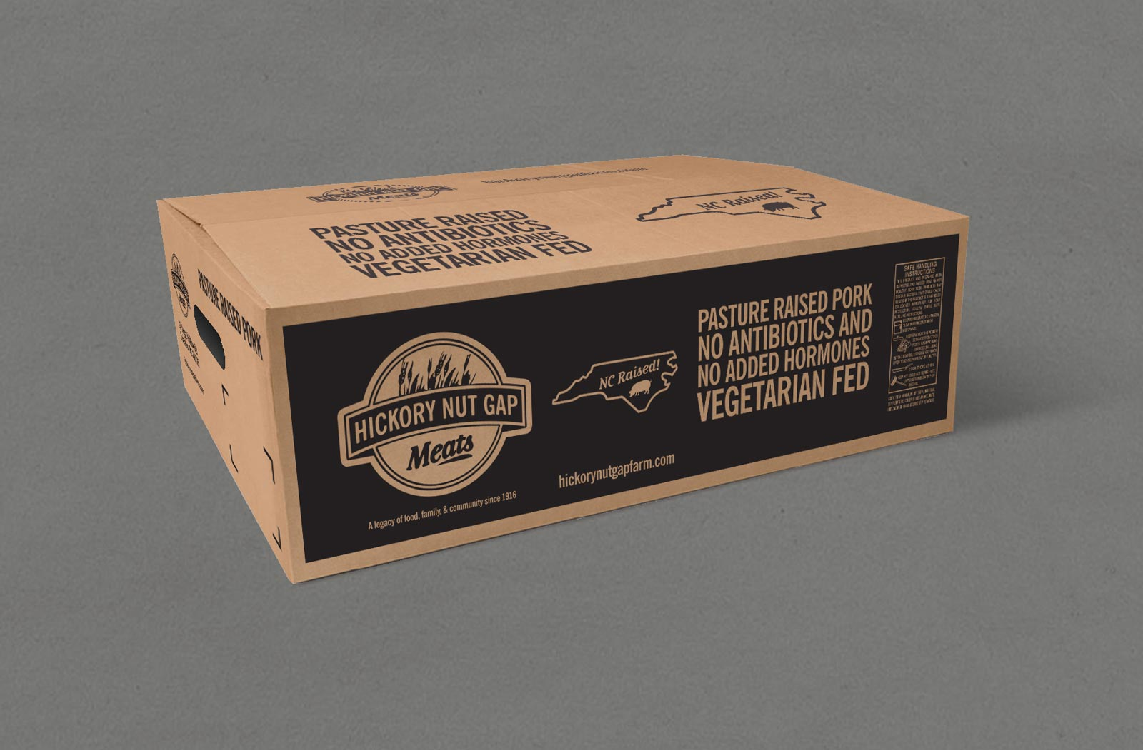 Hickory Nut Gap Meats Pork packaging/shipping cardboard box with black ink. Shown on gray background.