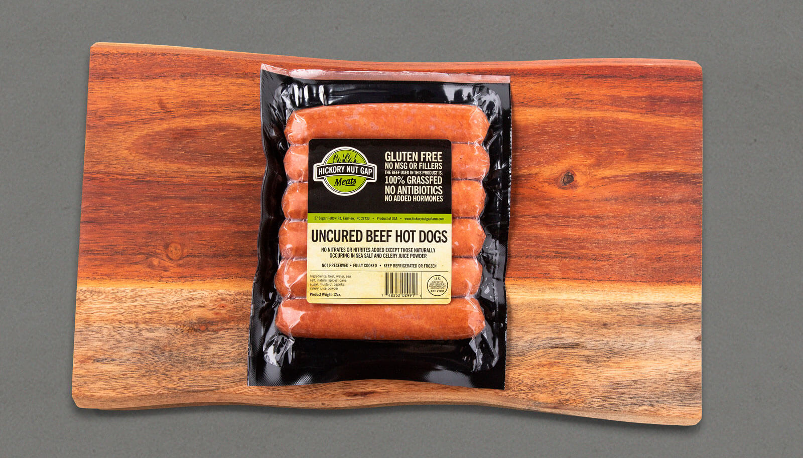 Hickory Nut Gap Meats Hot Dog label on package laying on wood cutting board