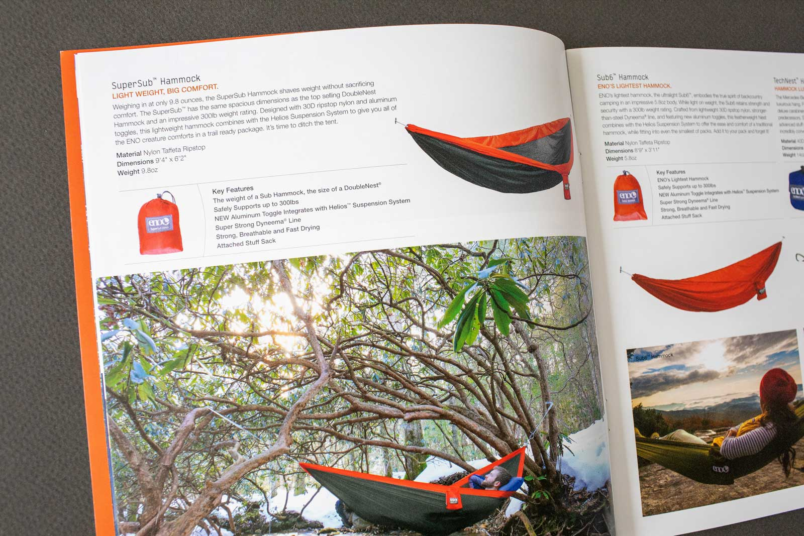 ENO Hammocks catalog spread detail showing hiker in hammock over stream with snow on the ground.