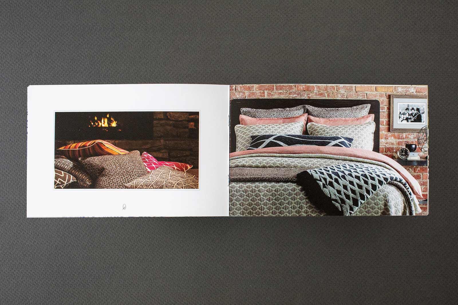 Catalog spreads for The Oriole Mill, showing a bed with woven pastel-colored comforter and pillows. Image showing factory worker.