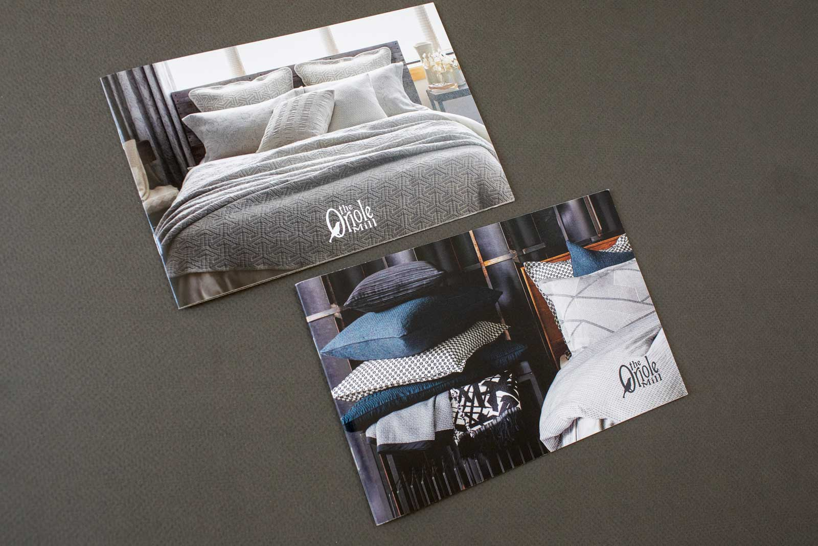 Brochure covers for The Oriole Mill, featuring pastel and neutral colored bed spreads and pillows with geometric patterns