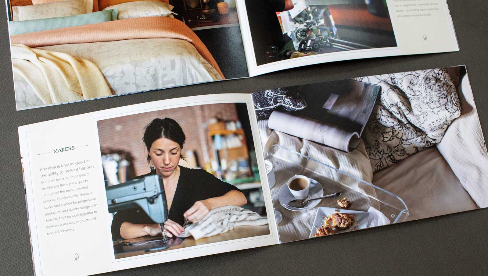 Catalog spreads for The Oriole Mill, showing a bed with woven pastel-colored comforter and pillows. Image showing factory worker sewing.