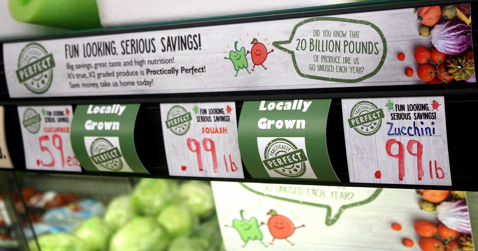 Practically Perfect brand signs for pricing shown above produce section