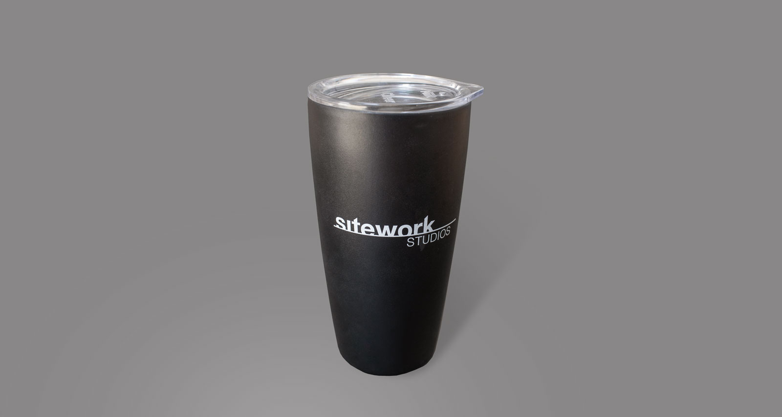 Sitework Studios landscaping logo in white, on a black coffee mug