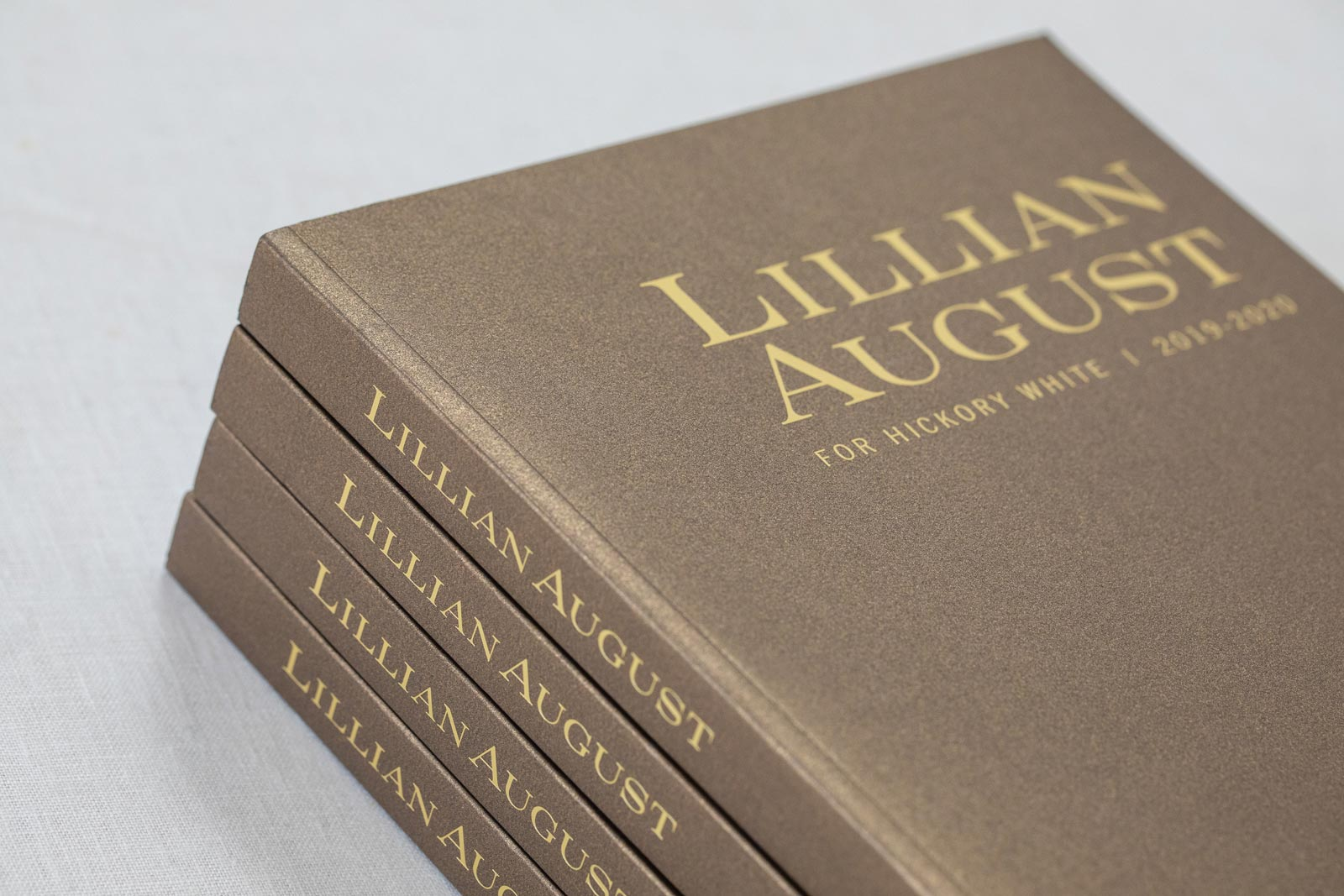 Lillian August Fine Furniture catalog cover in gold metallic paper and gold foil stamped