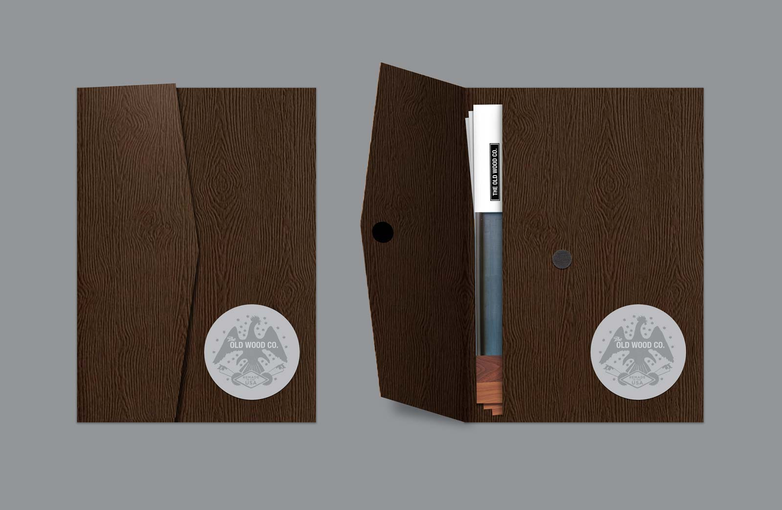 The Old Wood Company information card folder with wood grain texture and logo sticker