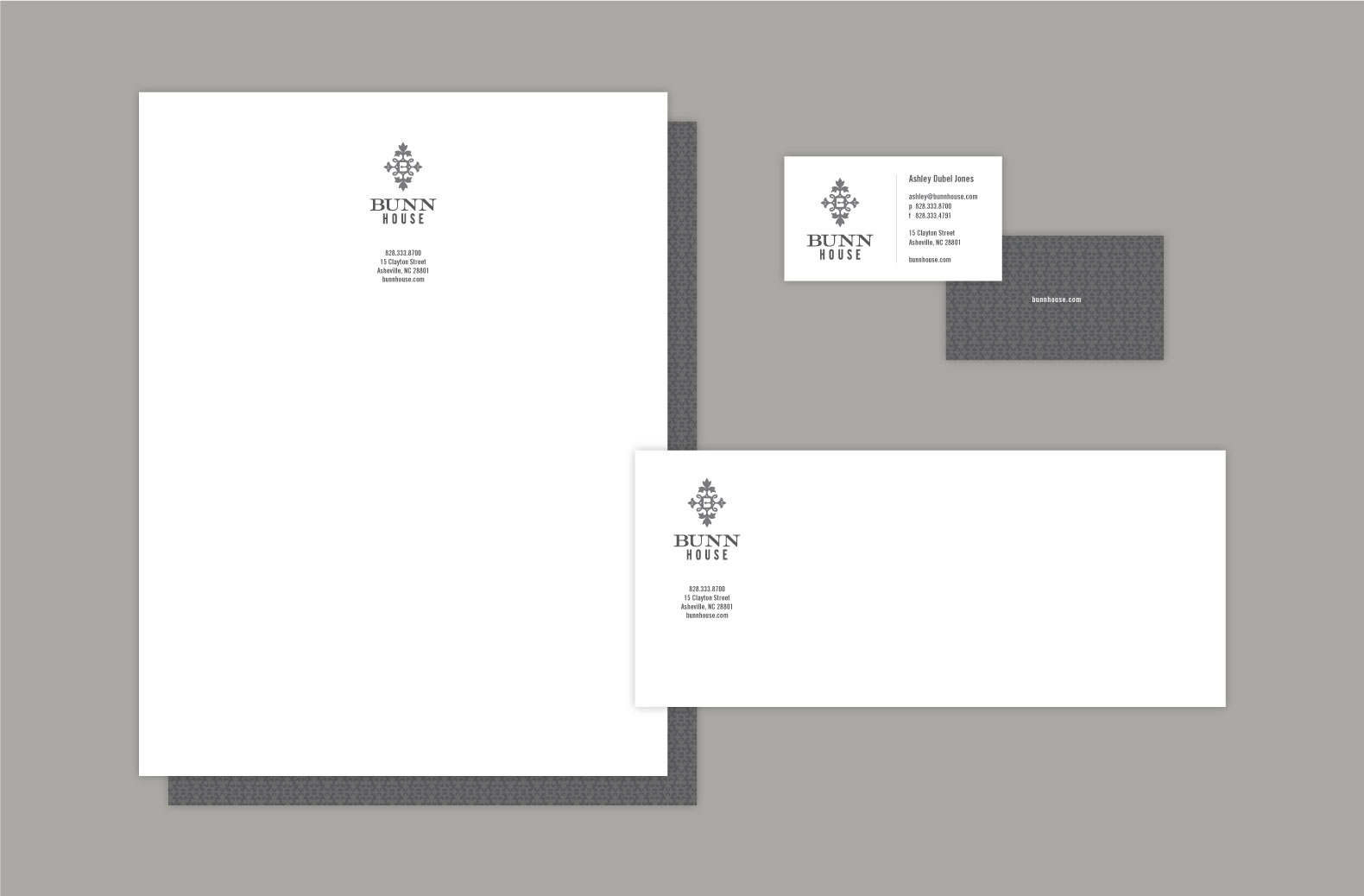 Bunn House Boutique Hotel stationery on natural paper and gray logo centered on letterhead and business card, Envelope.