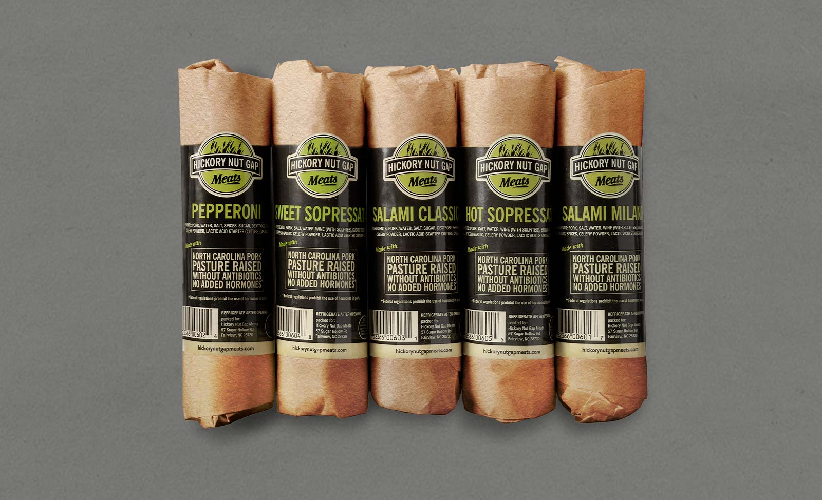 Hickory Nut Gap cured meats labels wrapped around kraft paper on gray background