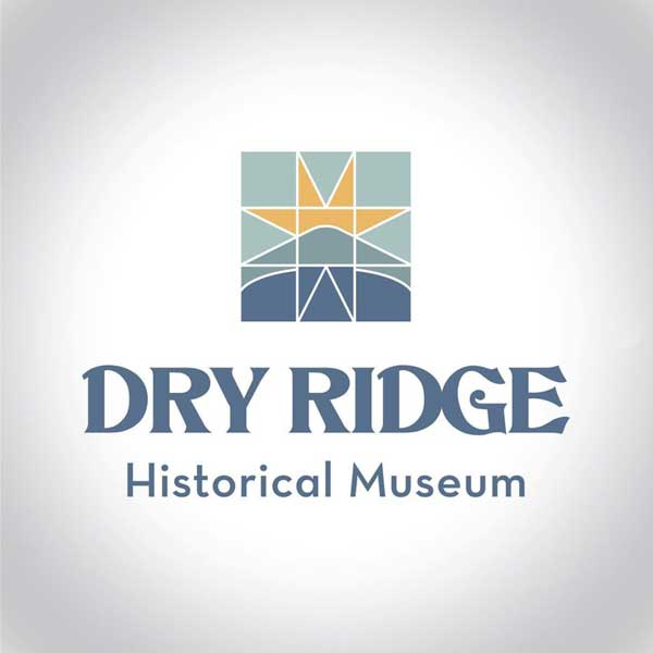 Dry Ridge Historical Museum logo of a quilt pattern of the sun mountains and lake