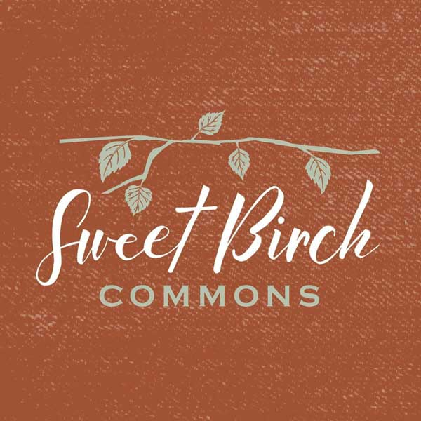 Sweet Birch Community logo of a birch branch and textured background