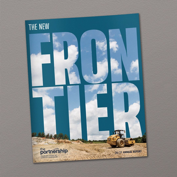 Henderson County Partnership for Economic Development annual report cover with heavy equipment and clouds inside type