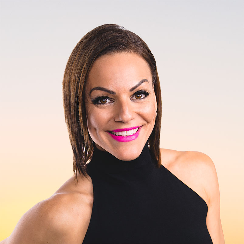 A headshot of Danielle Natoni smiling with hot pink lipstick and wearing a black sleeveless turtleneck dress against a sunset gradient background