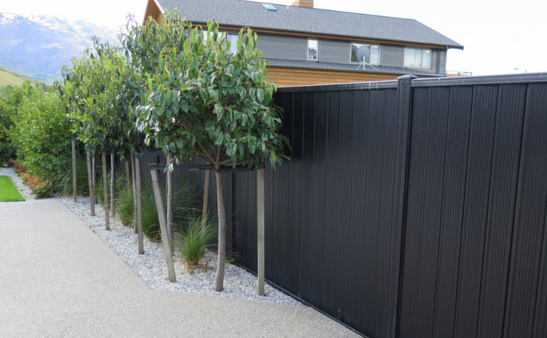 Wooden fence painted black