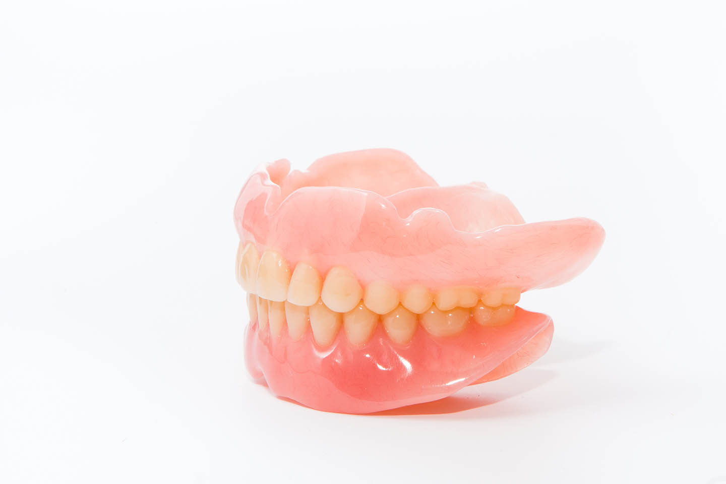 Dentures in front of white background