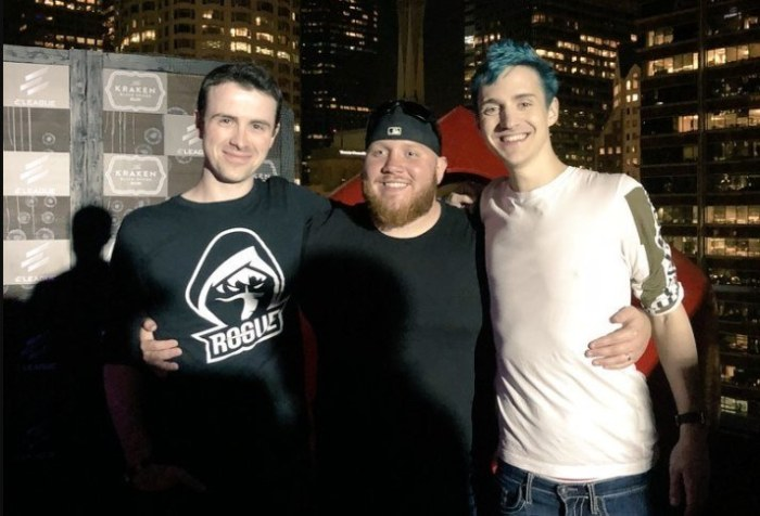Ninja, DrLupo and TimtheTatman posing for a picture on a rooftop bar.