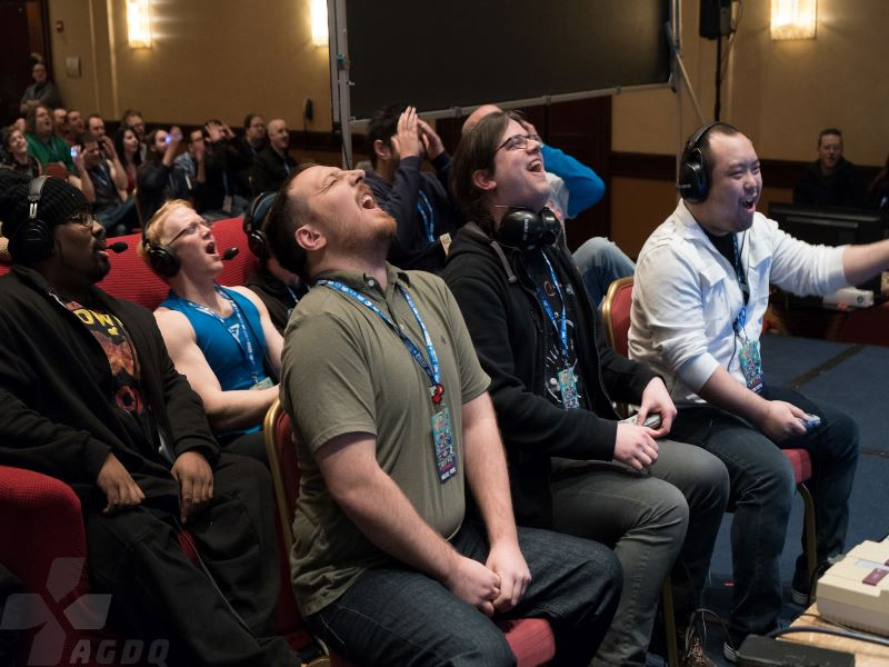 Spectators react to the fast-paced action of a speedrun