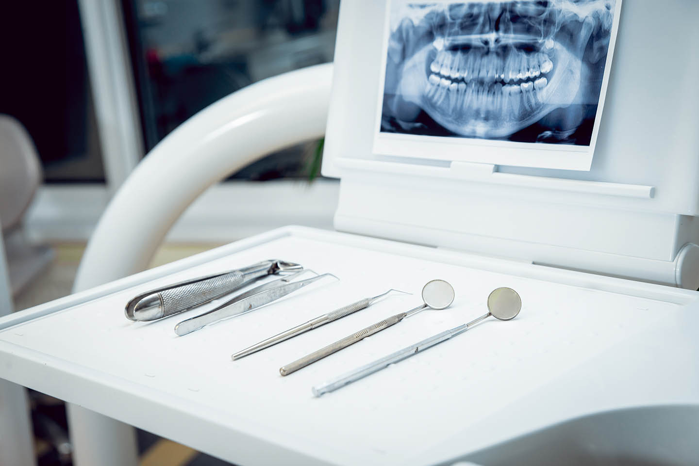 closeup of dental tools and x-ray