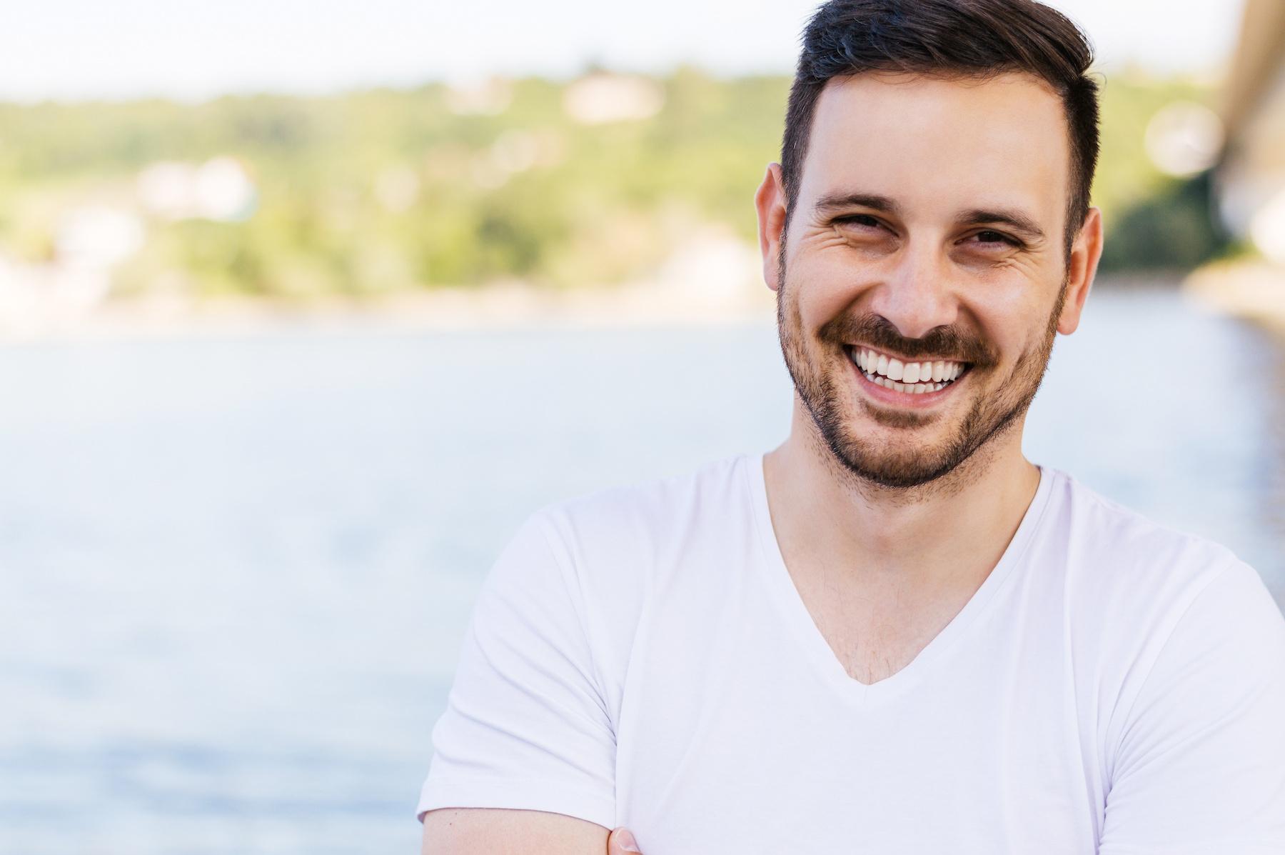 Man smiling after dental bonding treatment