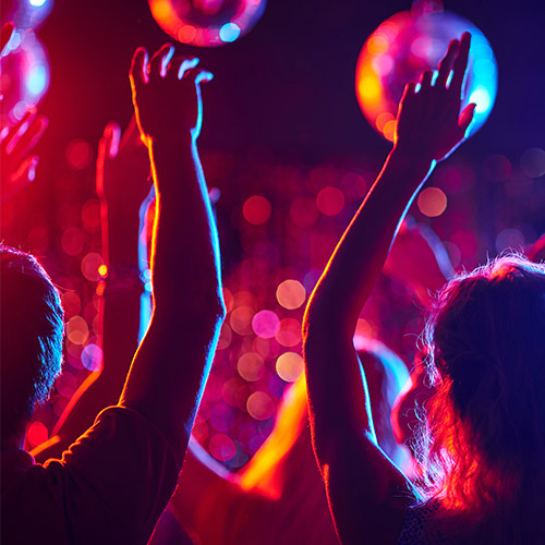 people dancing in a red lit room