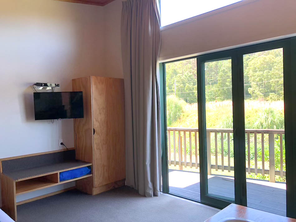 Book a bedroom at waitomo lodge