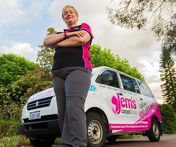Jem standing in front of her van