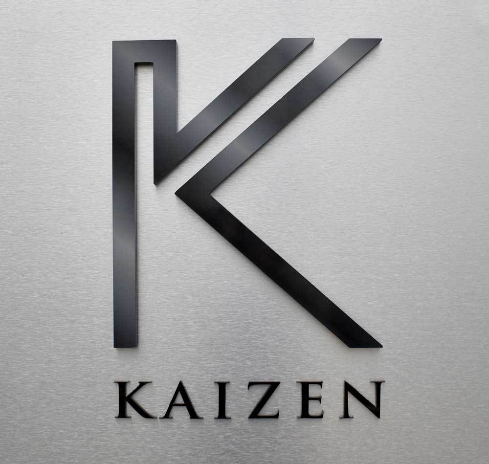 Image of the Kaizen building sign with the K icon and Kaizen lettering