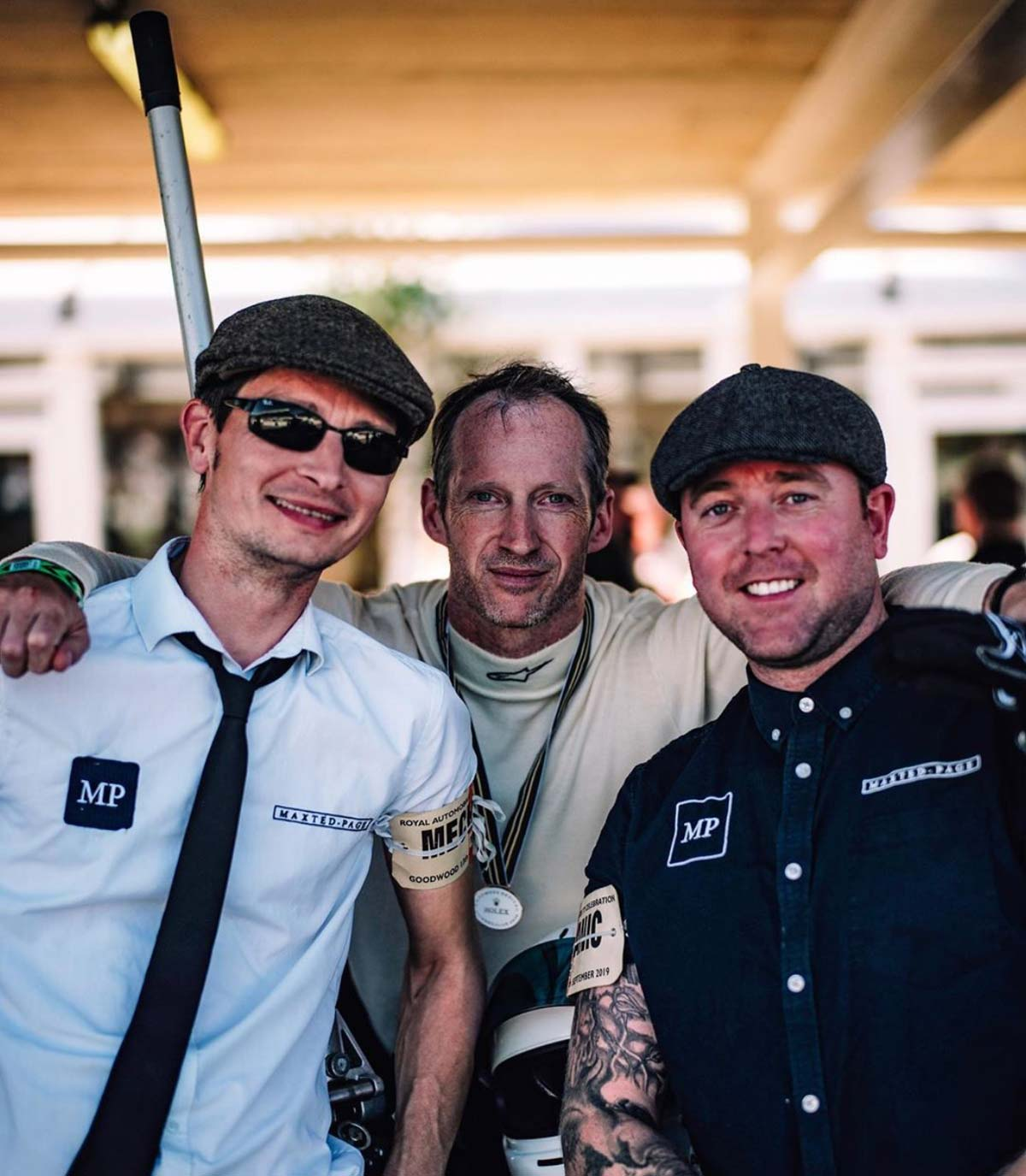 Maxed-Page driver and pit crew at the 2019 Goodwood Revival