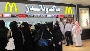 Men and women wait in separate lines to order at McDonald's in Riyadh's Faisaliah mall
