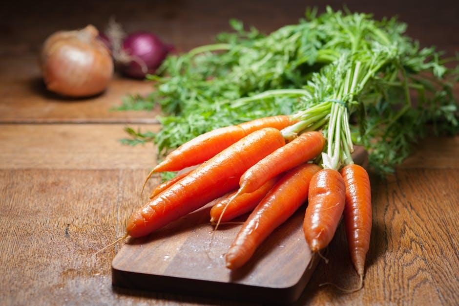 Fresh carrots on a cutting board