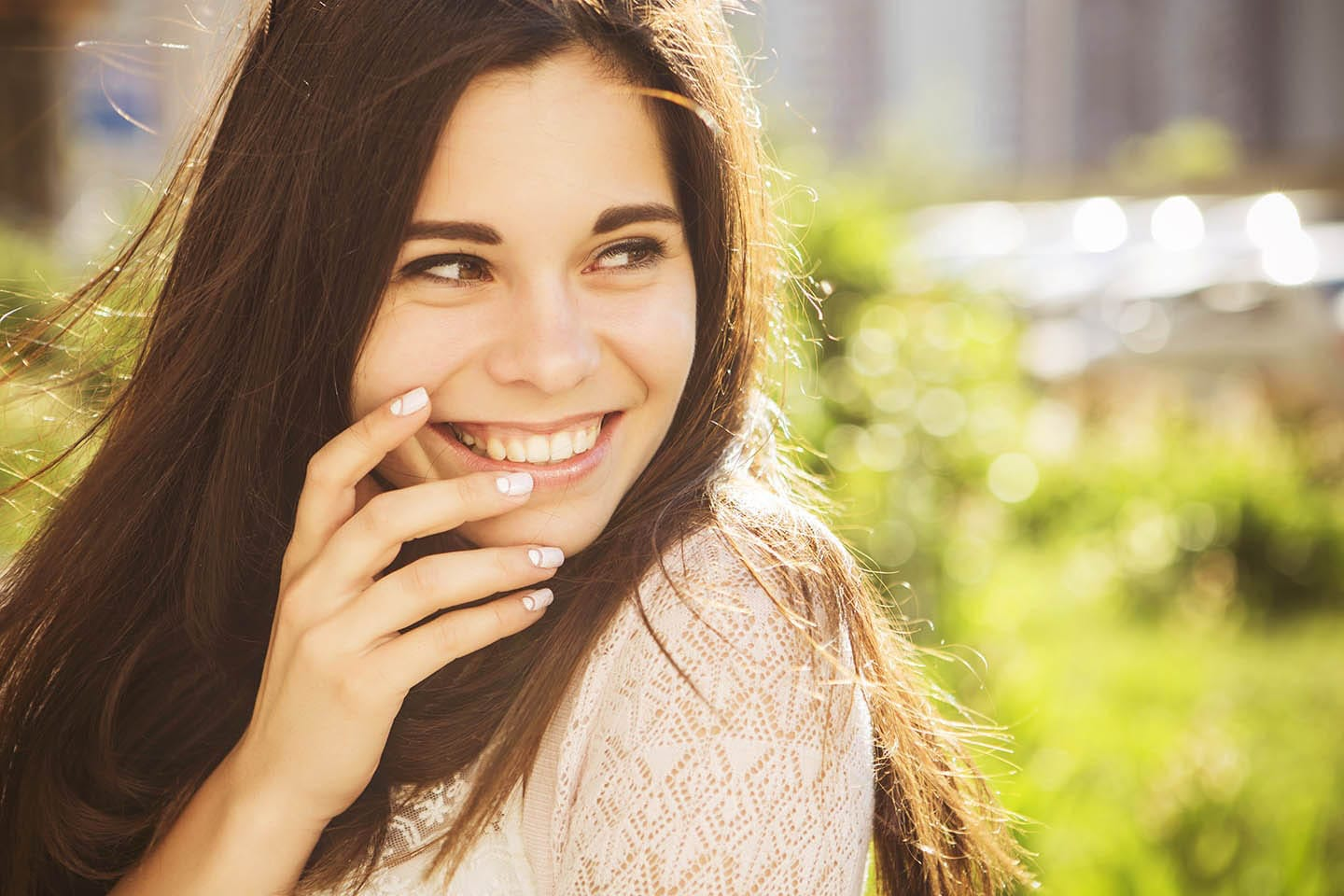 Girl smiling after teeth whitening treatment