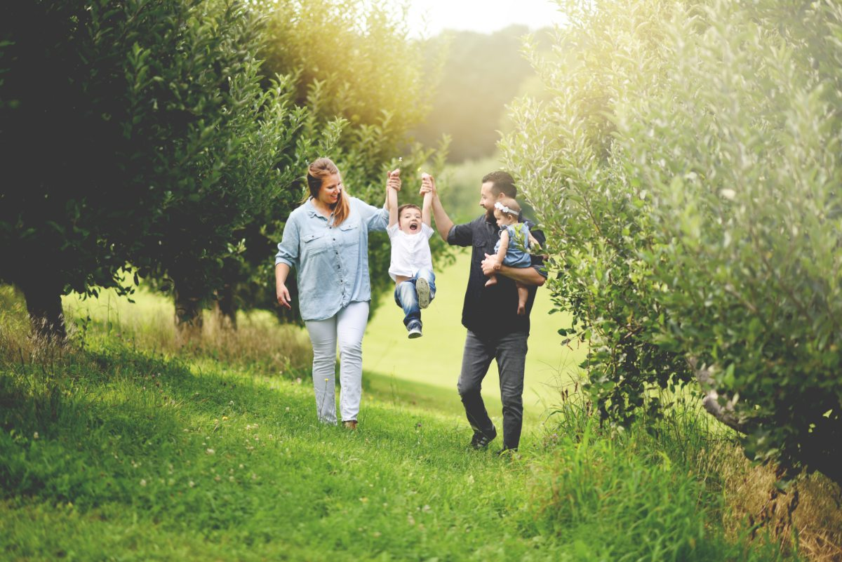 Dr. Yun walking in a field with his family
