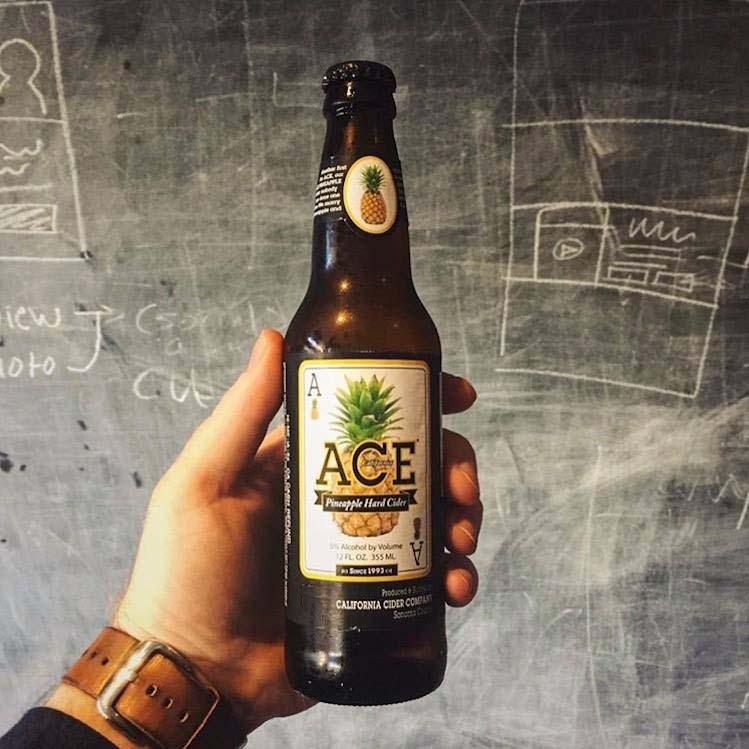 Ace Cider Hand holding bottle image