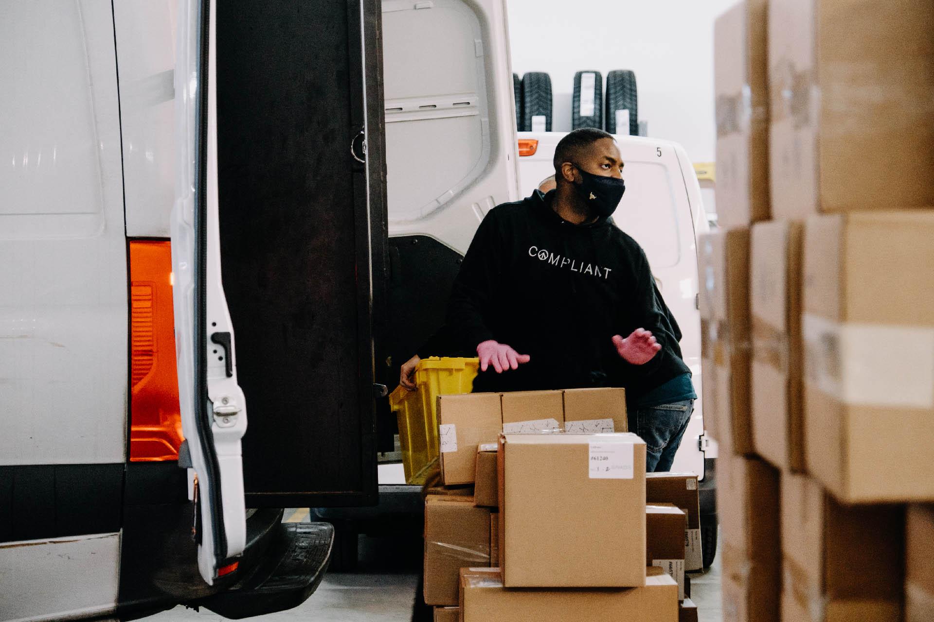 Nabis crew member loading a van.
