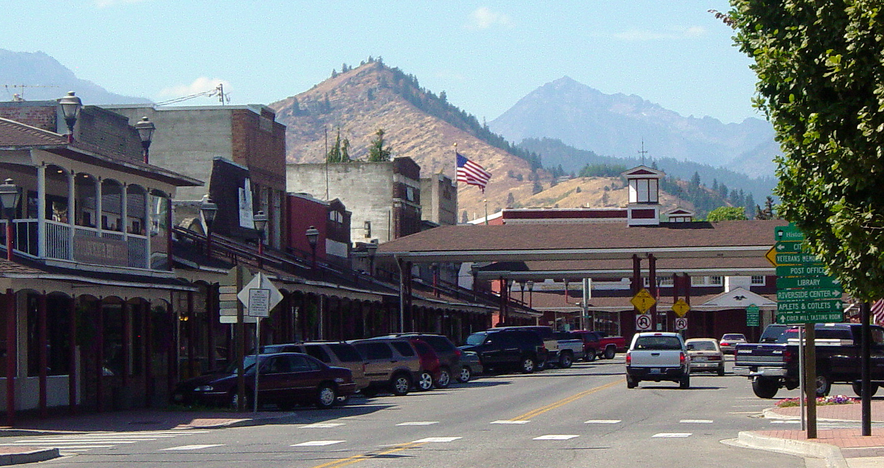 shot of small town with cars and mountains in backgroud