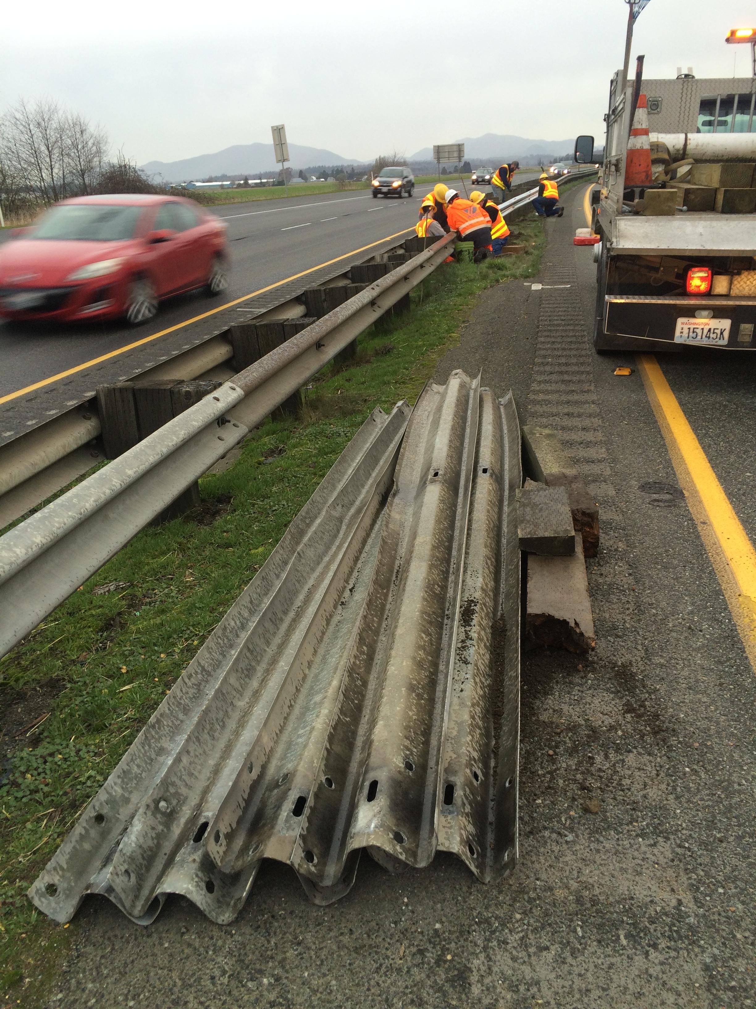 workers repairing median on freeway